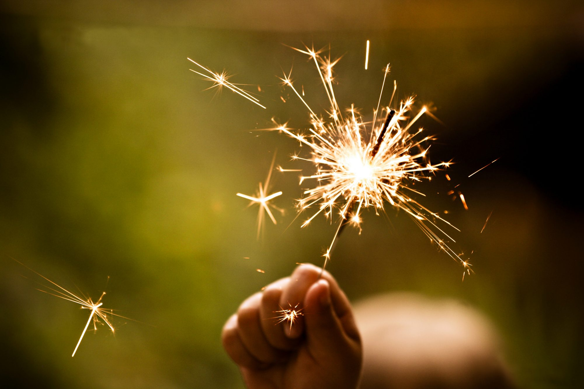 Sparkler in hand to represent supercharging your giving