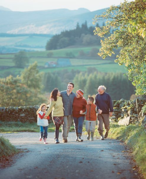 Smiling multigenerational family walks together
