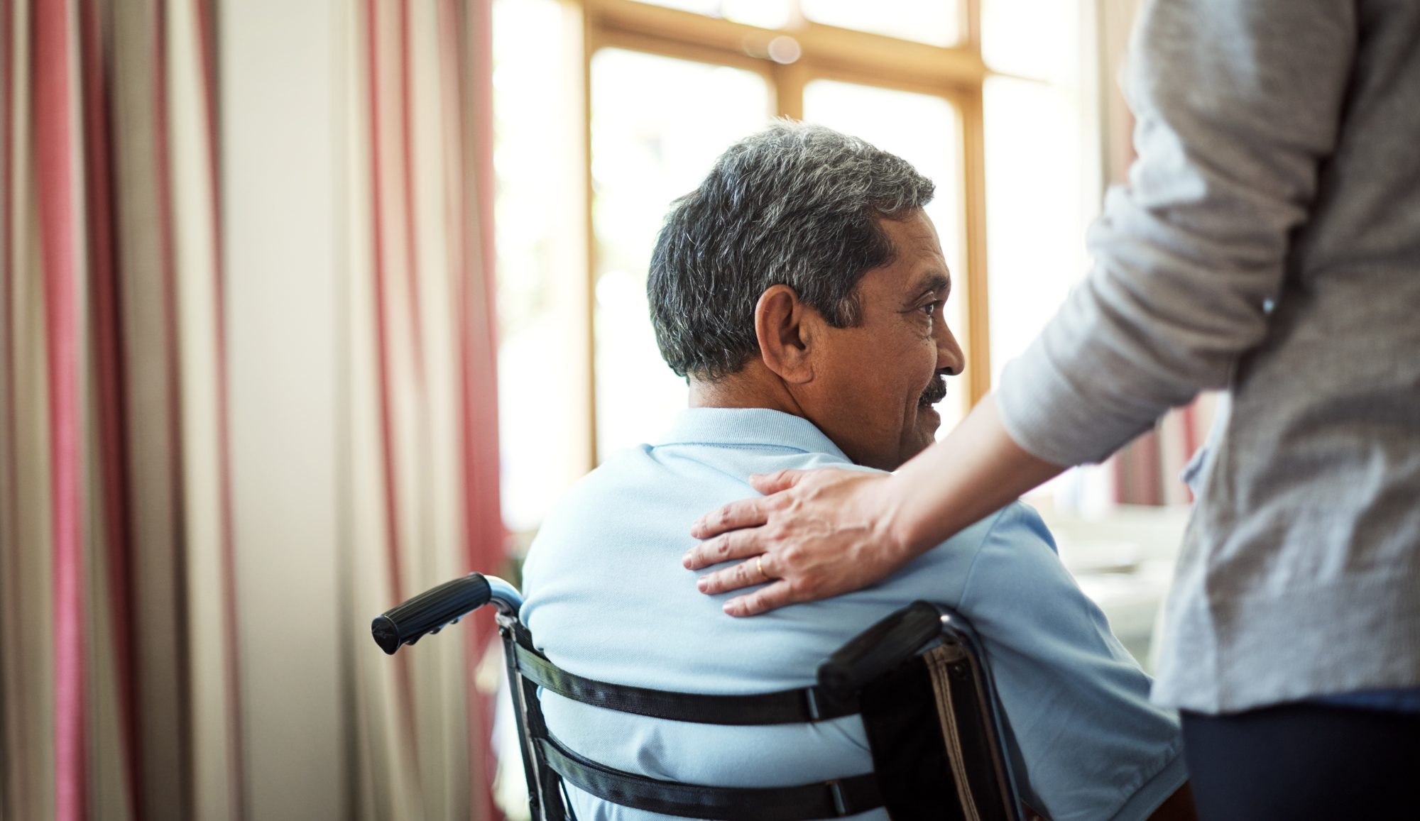 Nurse caring for a senior man in a retirement home
