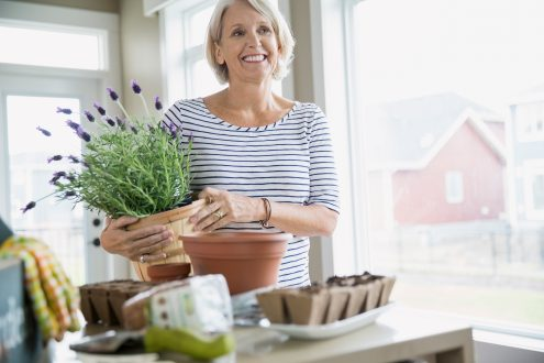 A happy Baby Boomer woman with flowers